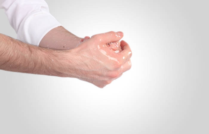 He washes his hands up to the wrists three times. It is recommended to do so three times.